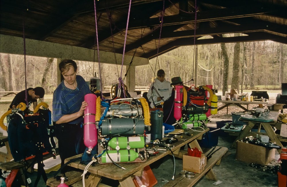 Ian Rolland, Noel Sloan, and Barbara am Ende (left to right) assemble Mk4 rebreathers at the Ginnie Springs pavilion near Devil's Eye spring. Photo by U.S. Deep Caving Team/Bill Stone.