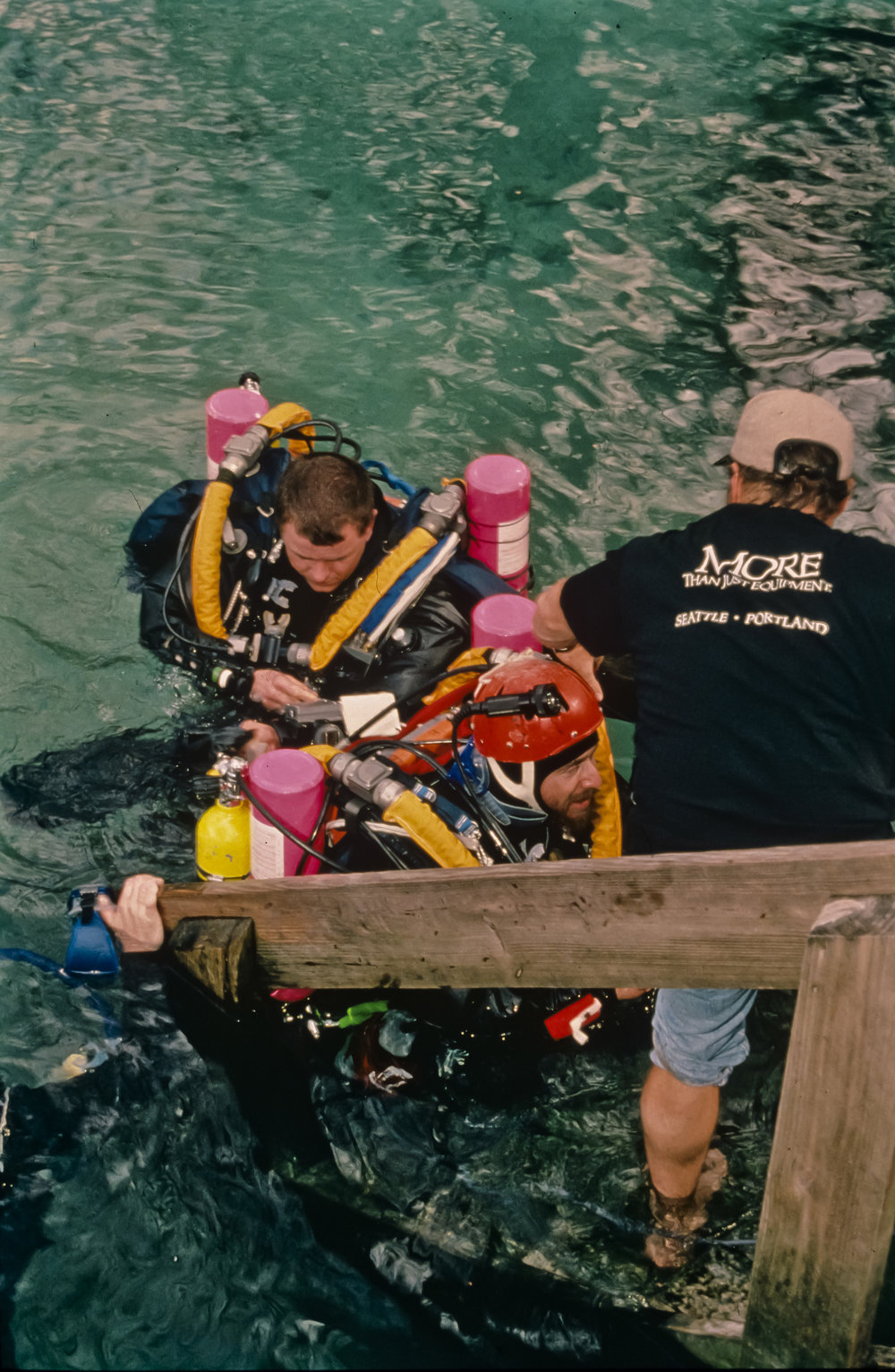 Rolland (top) and Broad are greeted by Wes Skiles following a two hour dive in Devil's Eye Spring. Photo by U. S. Deep Caving Team/Bill Stone.