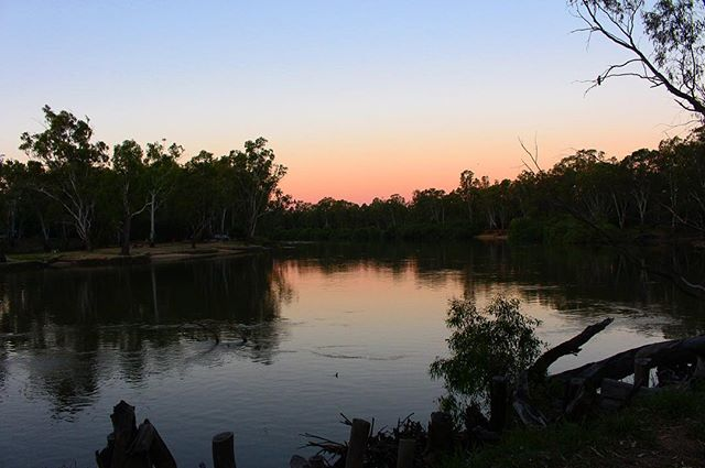 The Murray River at sunset 🌅. .  #murrayriver #sunset #photography #victoria #newsouthwales #nsw #photo #sun #afternoon #orange #blue #sky #corowra #reflection