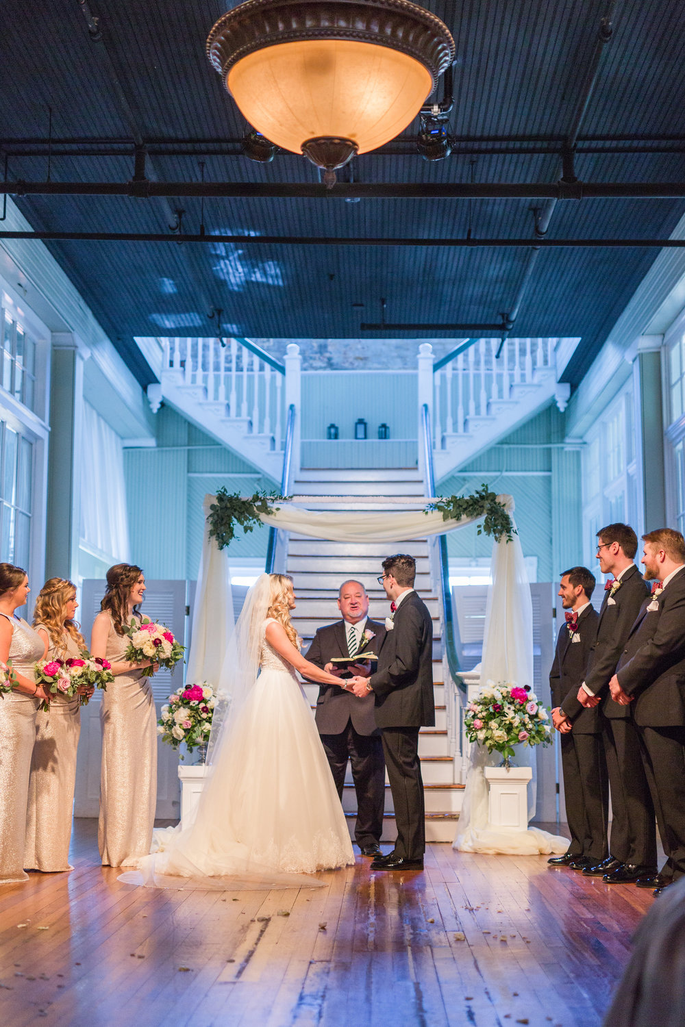 We incorporated the draping arch while insuring the florals matched the rest of the ceremony