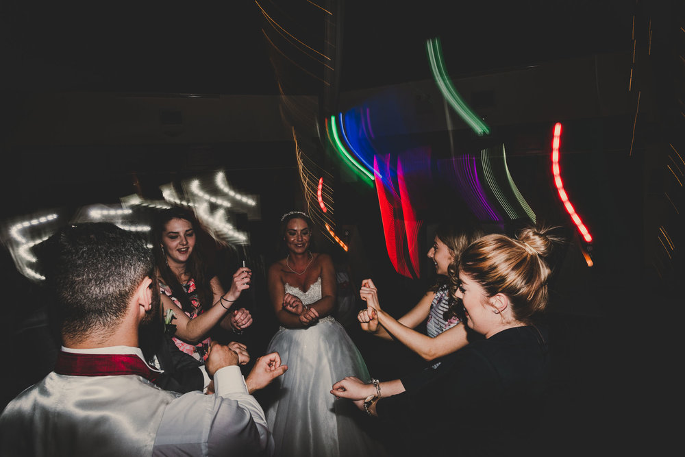alternative wedding photography of bride and groom raving