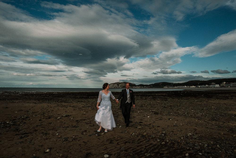 beach wedding bride wearing alternative blue for a rustic welsh alternative wedding