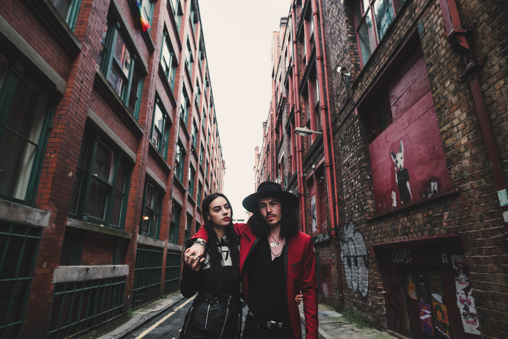 quirky rock couple of fashion bloggers in manchester city centre for their engagement shoot