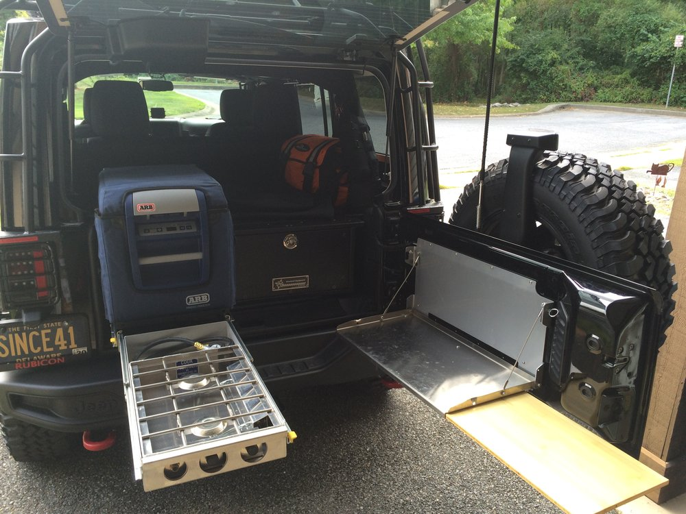 Full rear storage area with AT Overland box.