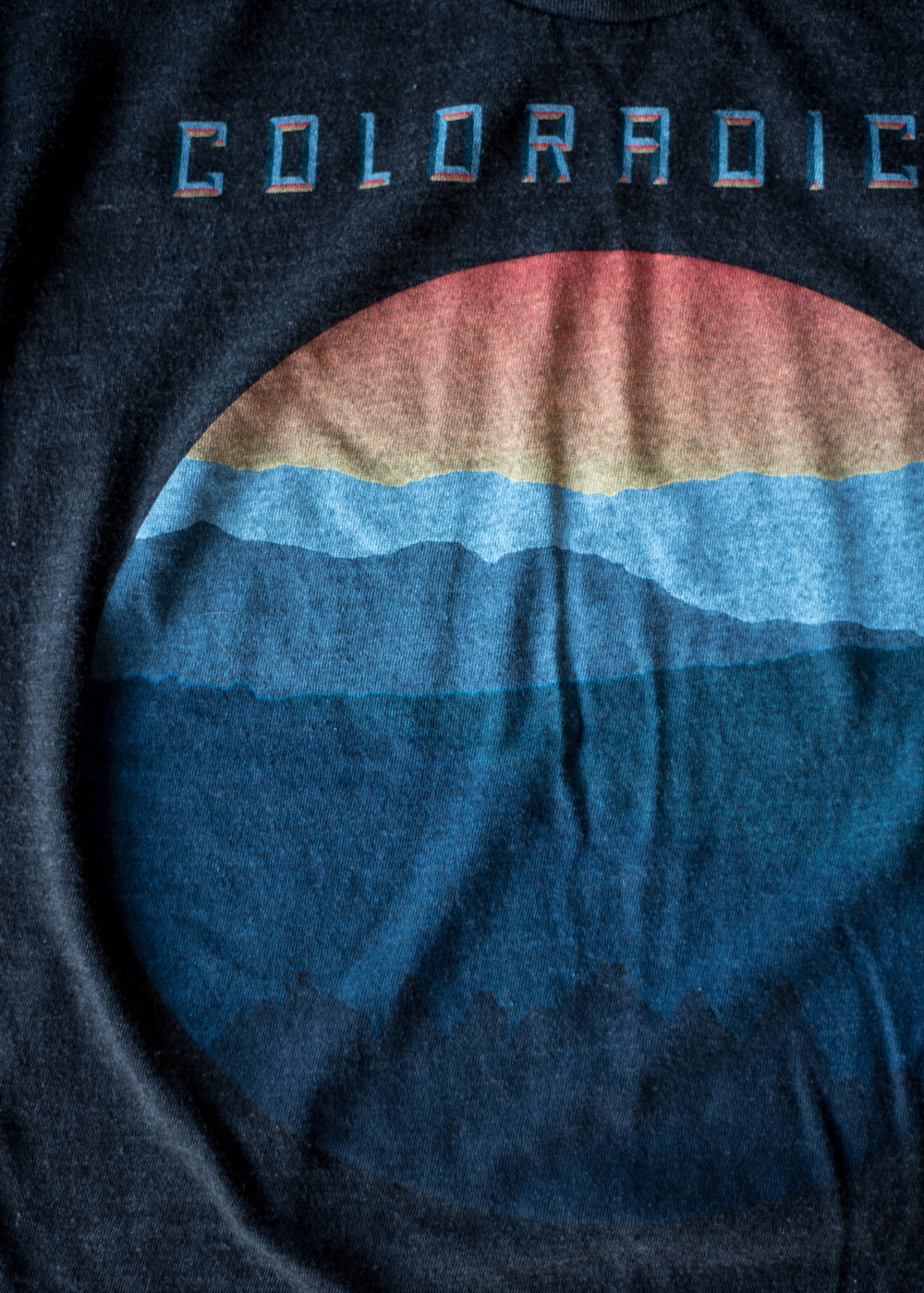 Coloradical. Print method SOFT. Screen printed on an American Apparel tri black shirt. Printed by A Small Print Shop.
