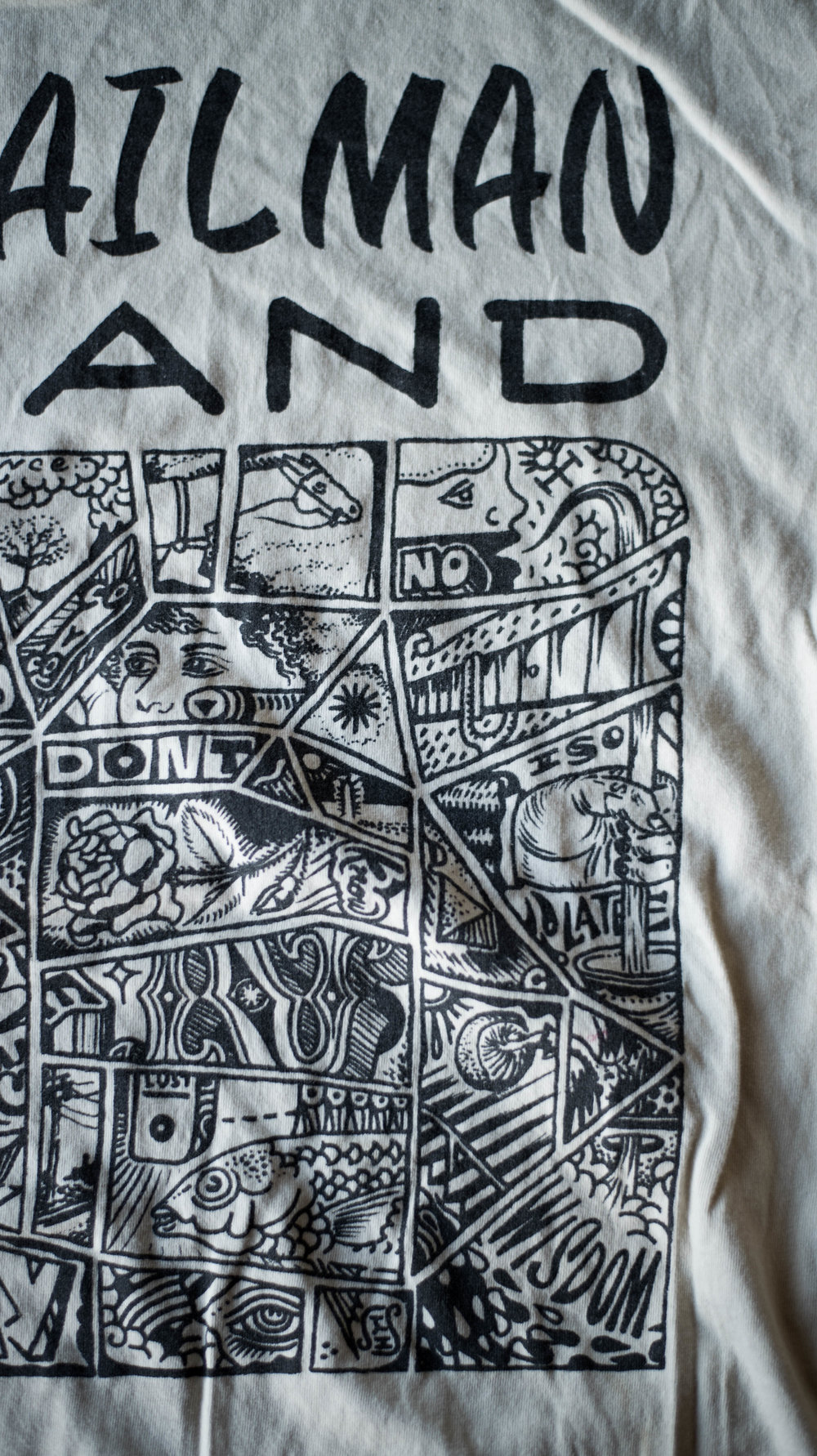Mailman Land. Print method VINTAGE. Screen printed on a Next Level shirt. Printed by A Small Print Shop.