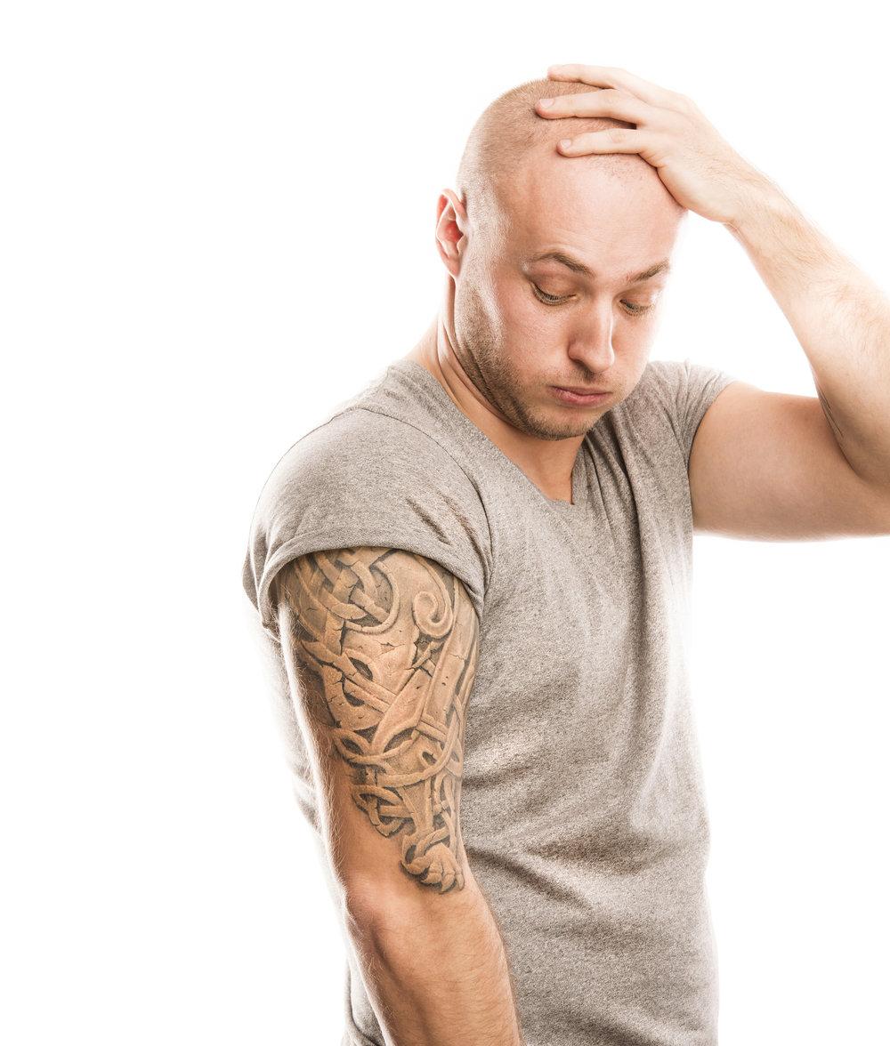 bigstock-Man-with-tattoo-58134692.jpg