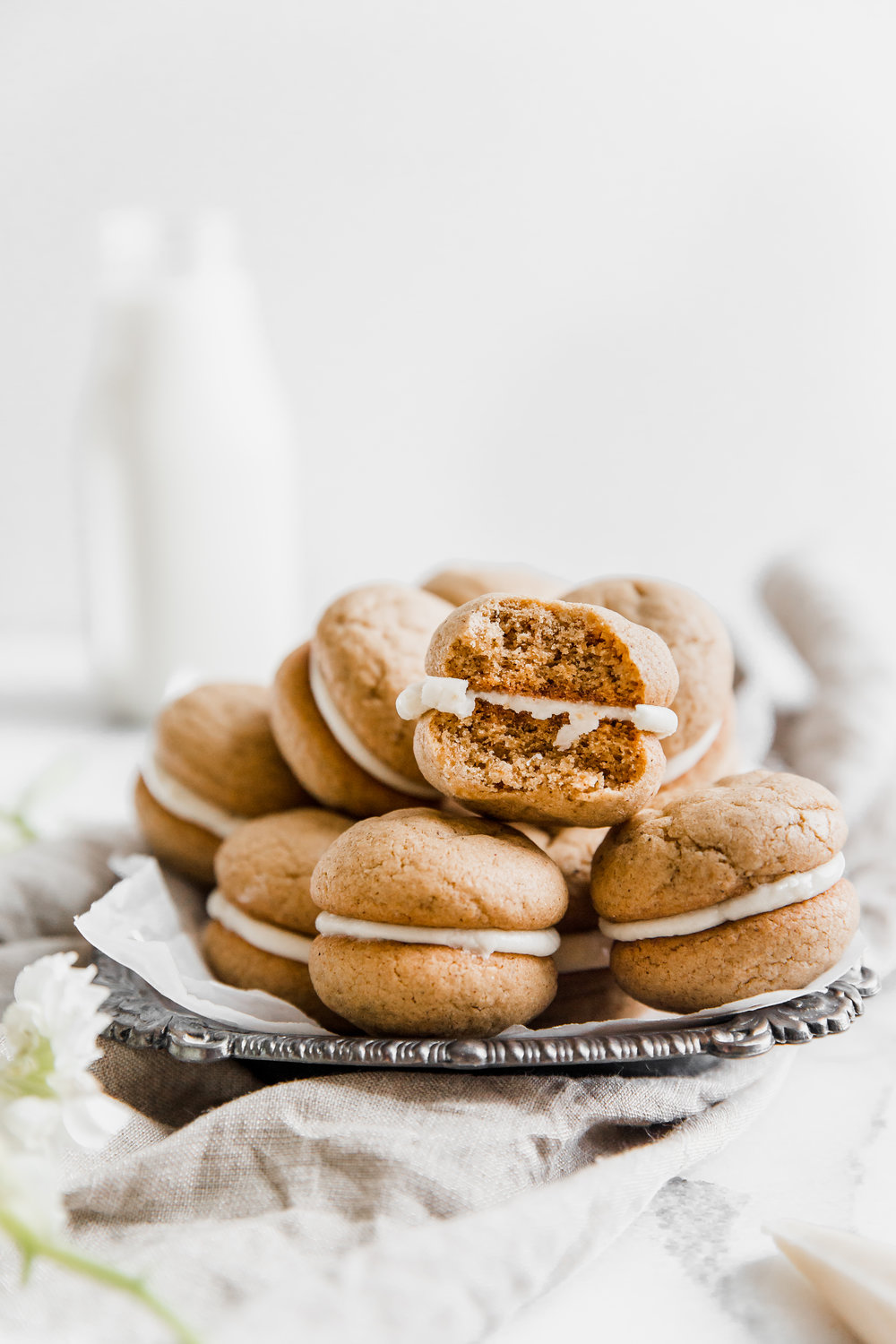Ginger Chai Whoopie Pies || To Salt & See. Imagine eating a gingerbread cookie while enjoying a chai latte, then put those together to make these whoppie pies! The cookies are packed with fall spices, and the middle layer is a maple buttercream icing. Easy to make and perfect for sharing... or not ;)