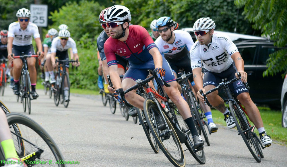 Patrick Torpey maintained great positioning in the Elite crit, until being pushed to the outside and prematurely ending his race in a conveniently soft bush (photo via the Tour de Millersburg Facebook page)