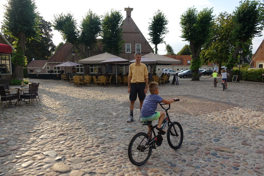 We made it to the moated town! (there were bikes there)