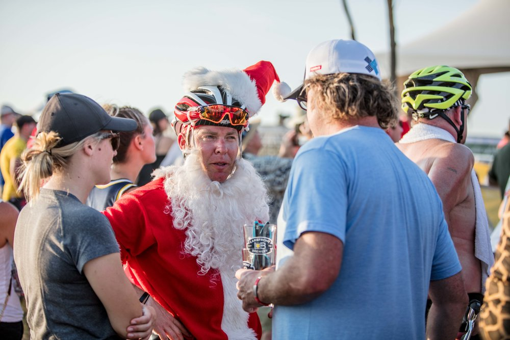 Racing in a Santa Claus costume during a 90 degree heat wave takes another level of fitness.