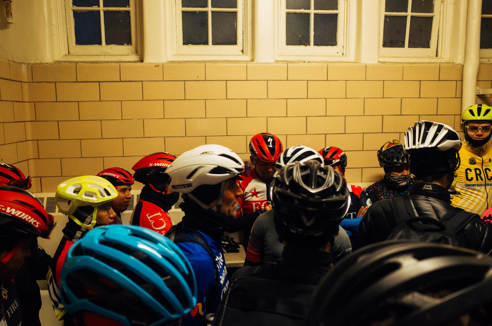A gaggle of racers trying to stay warm pre-race in one of the Central Park restrooms.