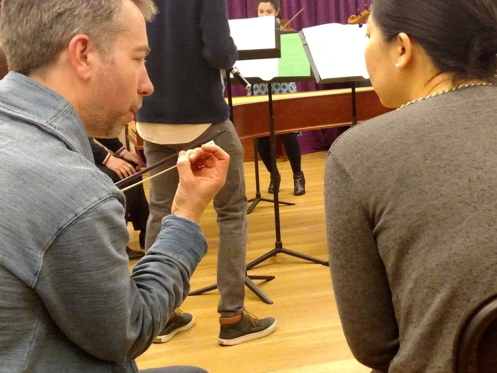 English Concert Principal Cellist Joseph Crouch (left) discusses the nuances of bow technique during a coaching session with Juilliard Historical Performance students.