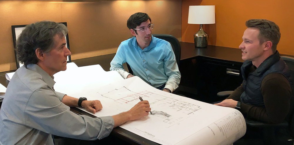 Principal architect Tim Barber (left) meets with director of operations, David Stone, (center) and director of design, Kirk Snyder (right).
