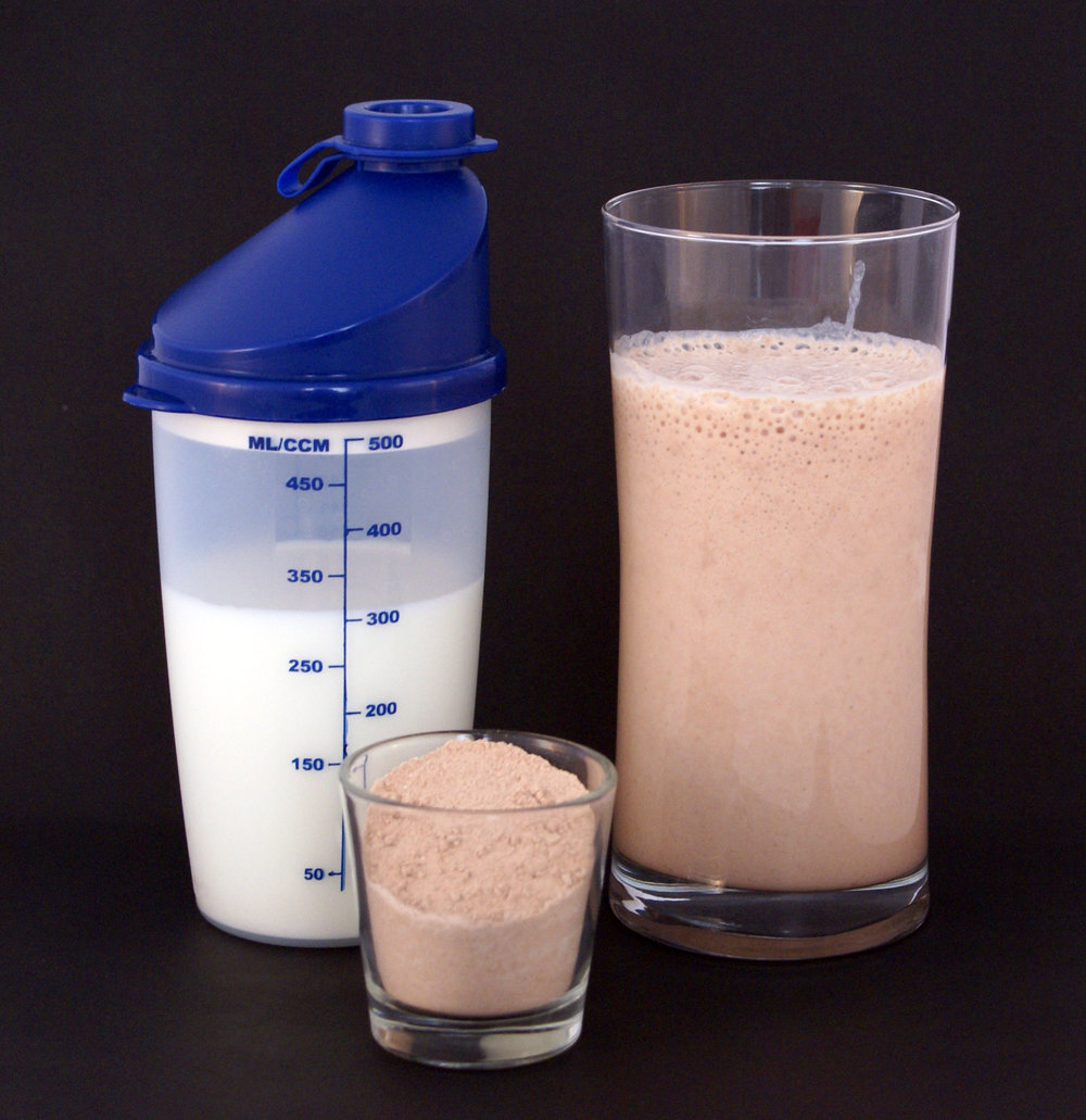 """A chocolate-flavored multi-protein nutritional supplement milkshake (right), consisting of circa 25g protein powder (center) and 300ml milk (left)."" Date 1 March 2009 Source Sandstein"