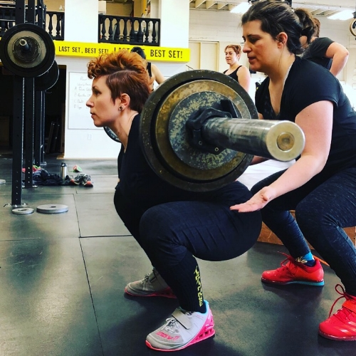 Janelle squats at Training for Warriors Portland