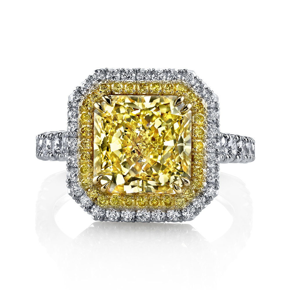 BEATRICE  natural fancy yellow radiant cut diamond set in a form fitted double halo setting. This design features two rows of french pave set diamonds french pave set around the center diamond as well as tiger claw prongs in yellow and white gold.