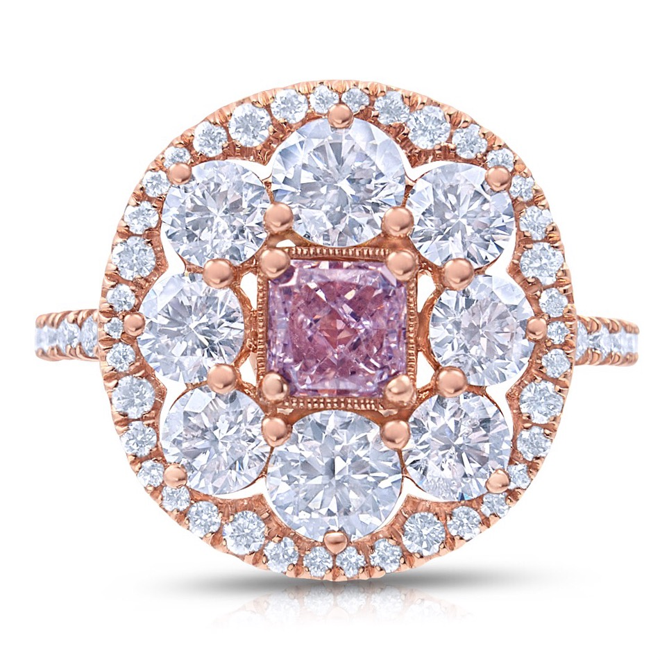 PINK BLOSSOM  natural fancy purplish pink radiant cut diamond set in a truly unique floral setting. This design features over two carats of round brilliant accent diamonds carefully set in rose gold.