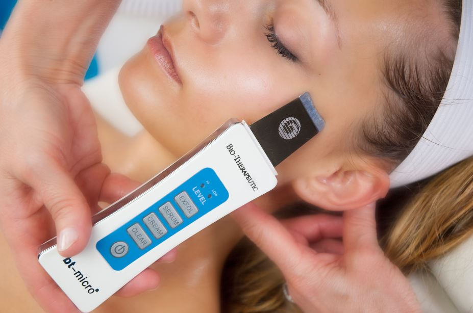 The Bt-Micro Ultrasonic Exfoliation is a facial treatment device that uses millions of tiny vibrations to gently lift and release dead skin cells and impurities.  On the flip side it uses millions of tiny vibrations to press nourishing treatment products into the dermis, the layer of skin beneath the surface.  This tool will help to diminish fine lines and wrinkles, decongest and clarify acne-prone skin, firm and plump the skin, and reduce pore size.      The Bt-Micro is used in our Bt-Cocktail Facial and Ultrasonic Express Facial.