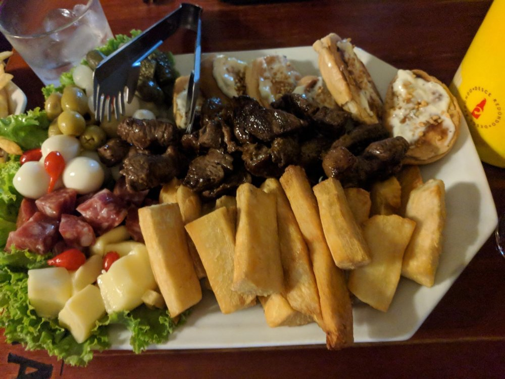 Steak, garlic bread, charcuterie, olives (not a fan, never will be), salad and yucca fries! We also got salad and another plate with grilled chicken and actual fries