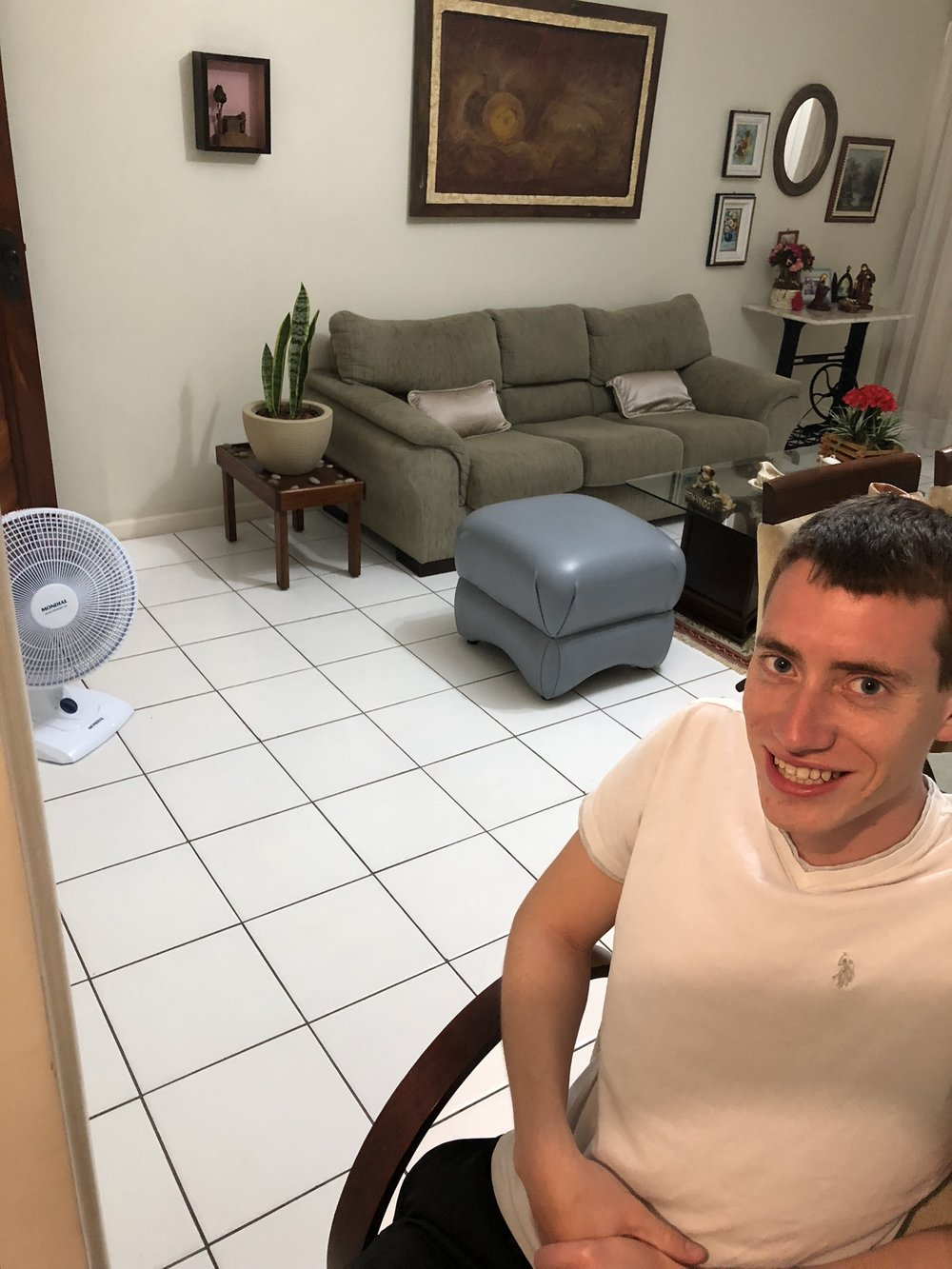 This was on our second night but I just wanted to show my uncle's living room! Kevin was dying of heat and they only keep AC's in their rooms so my uncle set up a fan for him. Kevin sat in the doorway of the kitchen so he could still talk to us lol :)