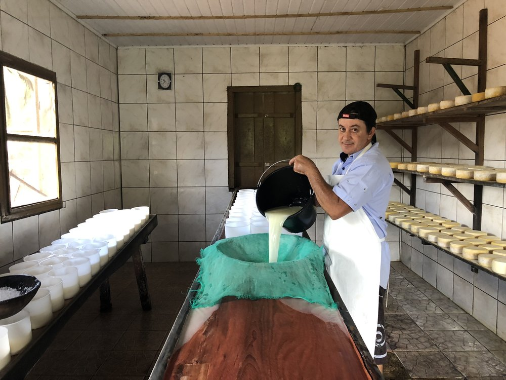 My Tio Marquinho making cheese. My dad calls him Jose which was my grandfather's name. When he died, my uncle took over the business :)