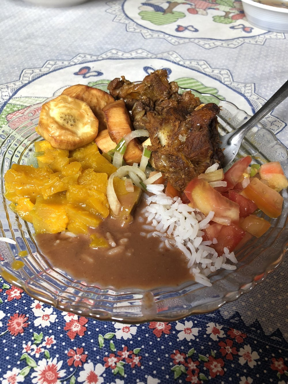 Typical meal: Rice and beans (always), ribs, tomatoes and plantains