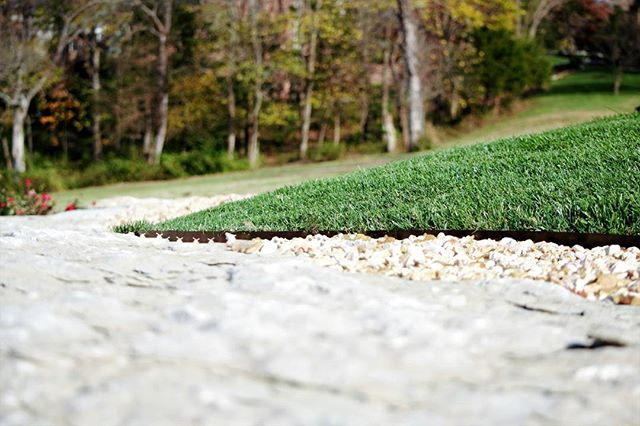 Natural Rock, Green Grass, Pops of Color. It's what we do. #outdoorinnovationsfor417land #outdoorliving #hardscaping #greengrass #roses