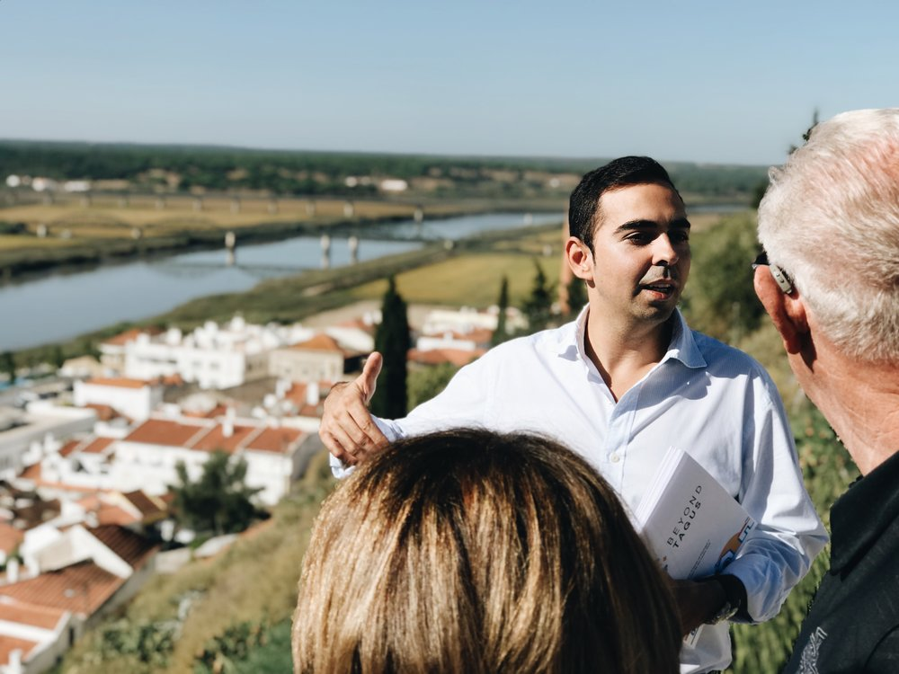 Gonçalo discusses the history of Alcácer do Sal with trip attendees