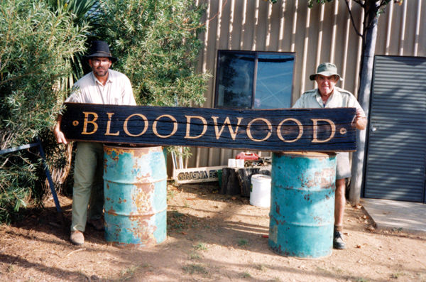 Steve and Roy Doyle with the very first Bloodwood sign made from a local Bloodwood tree