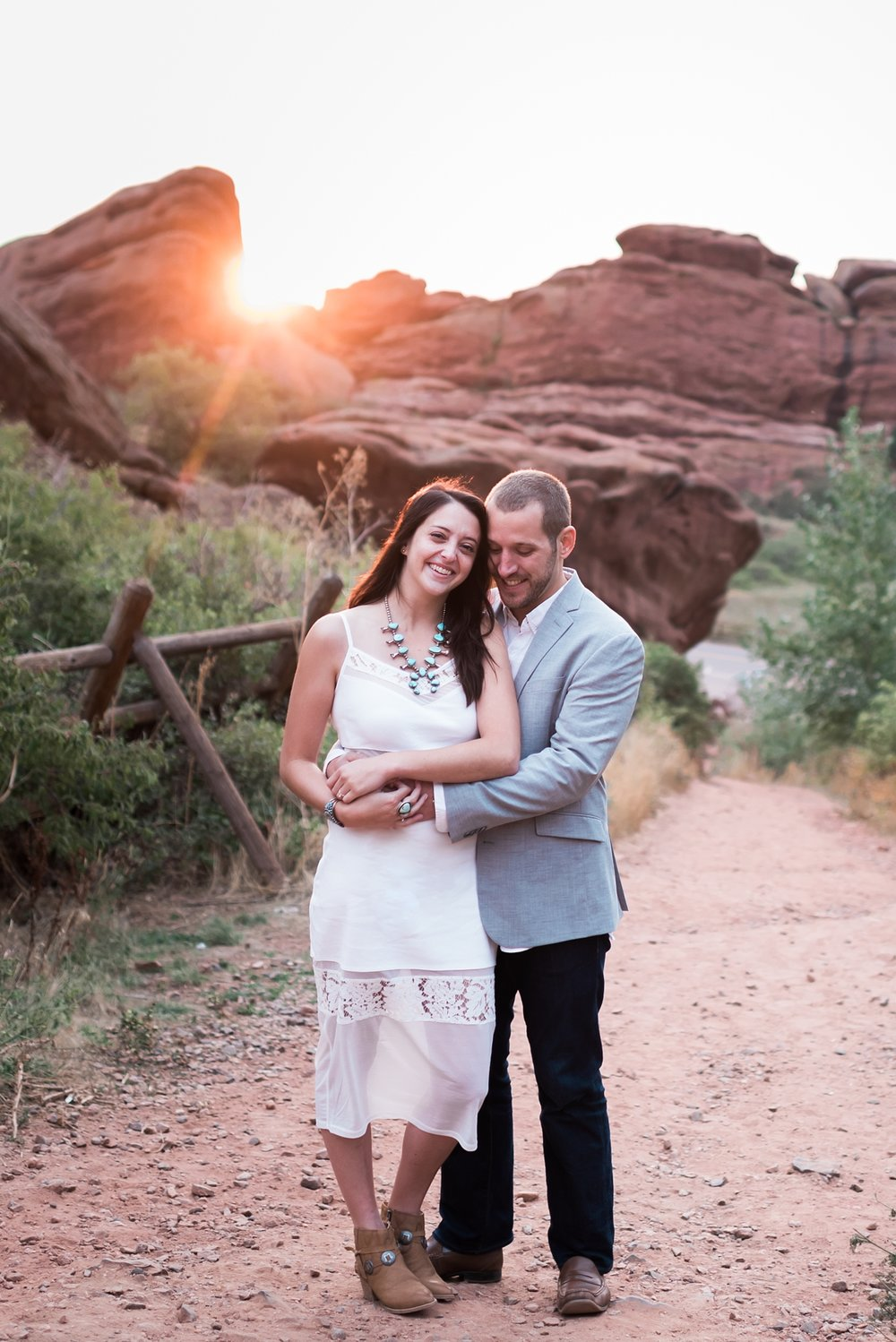 I helped out fellow photographer, Rayna McGinnis, and shot a sunrise engagement session for at Red Rocks. This couple and the light had me swooning all morning!
