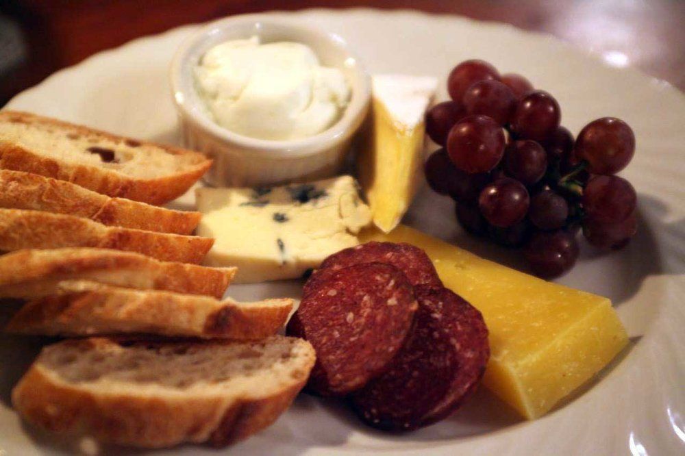 Try our local cheese & charcuterie plate... withChaseholm Farm Nimbus, Berle Farm Berleberg, Rawson Brook garlic and chive chevre, Amish blue cheese, Highland Farm venison summer sausage, Jacuterie sopressata, Empire apple, house-made pickles and toasted Berkshire Mountain Bakery baguette.