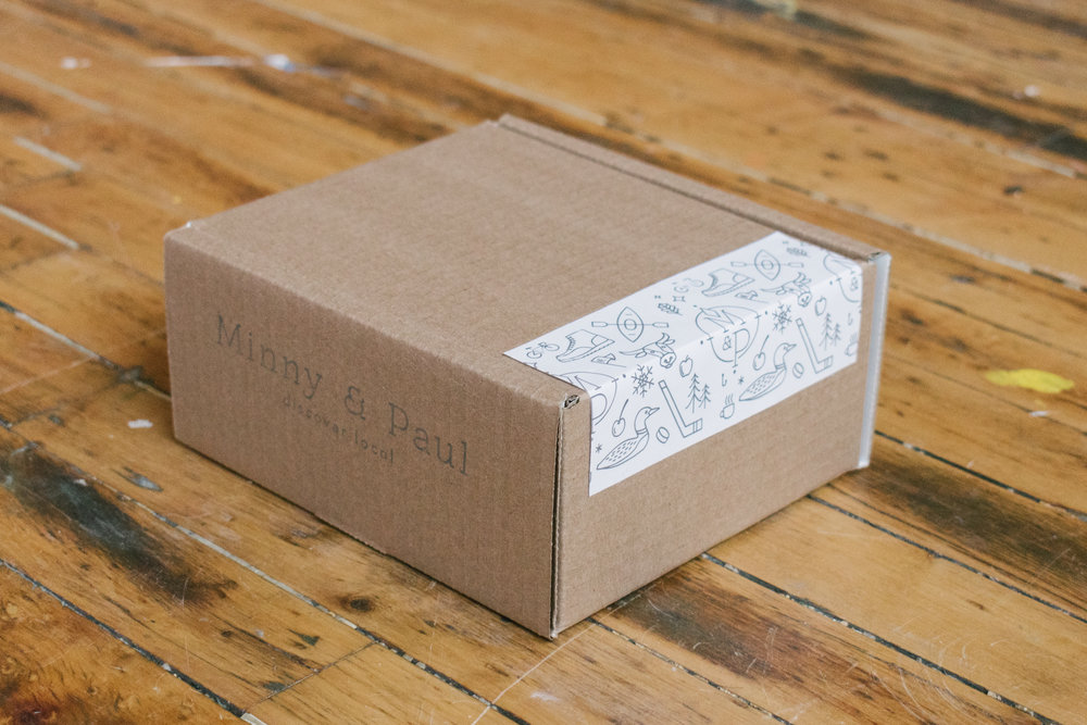 The newly designed and illustrated packaging tape for M&P, featuring Minnesota iconography.
