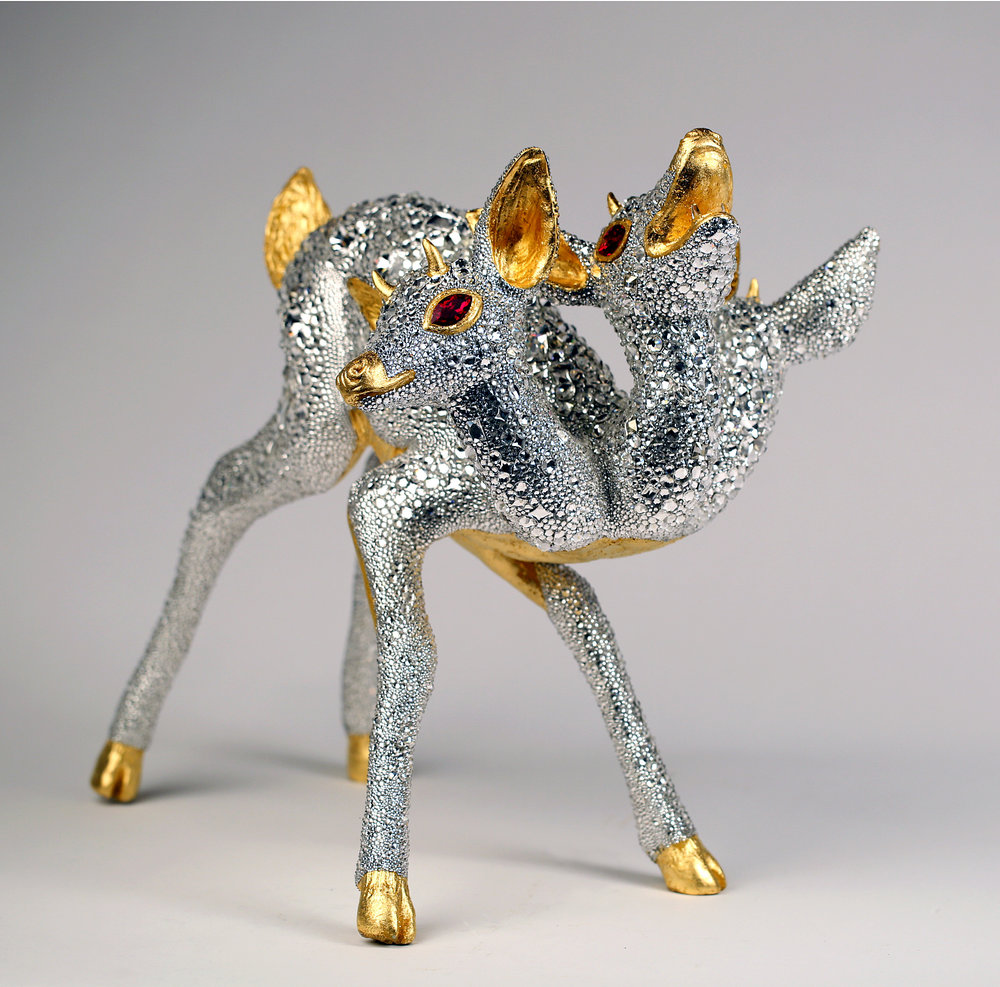 THE HUNTER'S FOLLY by Elizabeth McGrath, Mixed media with 50,000 + Swarovski Crystals & 24K gold leaf, 2 1/2″ W x 19 /2″ H x 17″ D