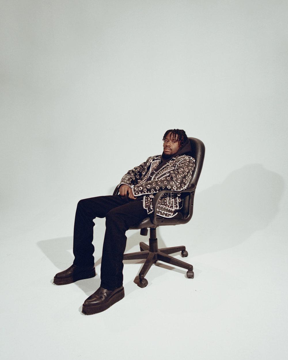 Shameik wears Jacket by La Roxx, Sweatshirt by Karl Kani.