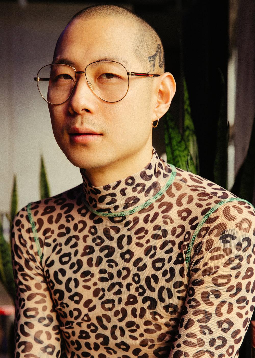 Danny wears top by Sandy Liang.