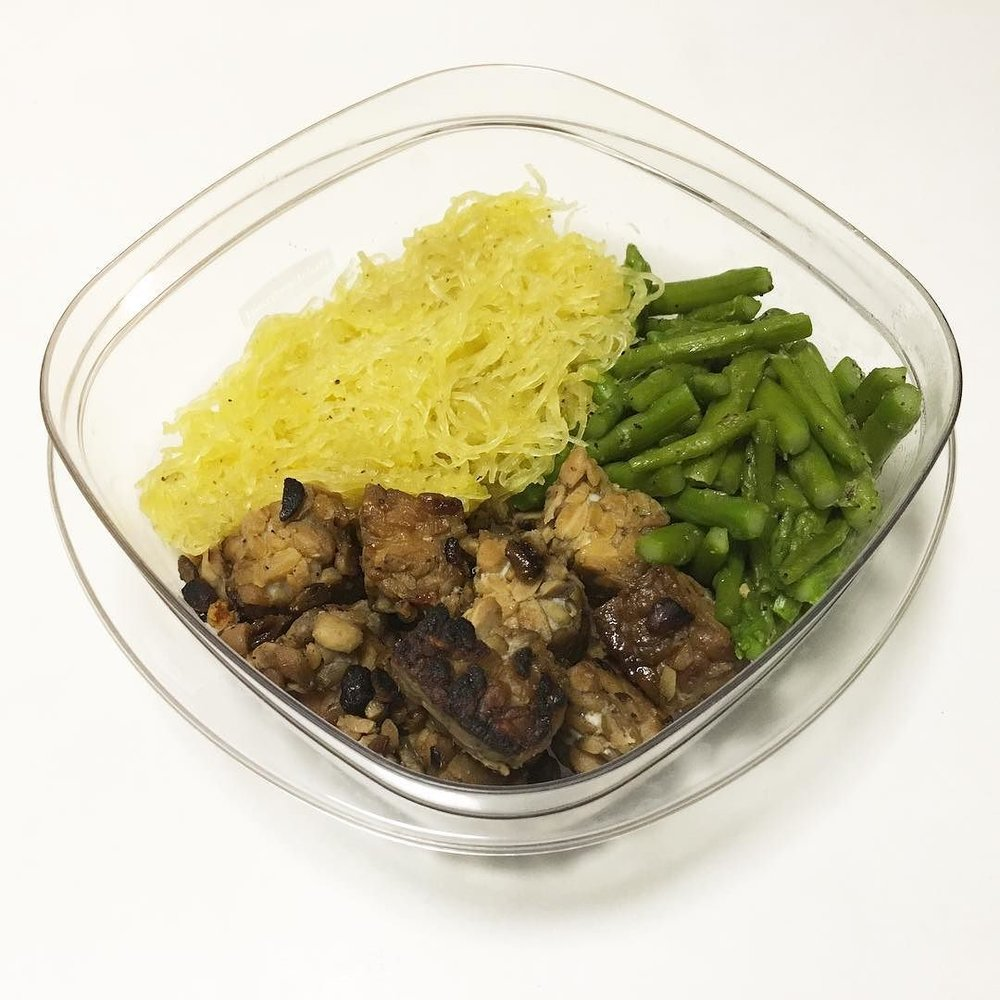 TEMPEH SERVED WITH ASPARAGUS AND SPAGHETTI SQUASH