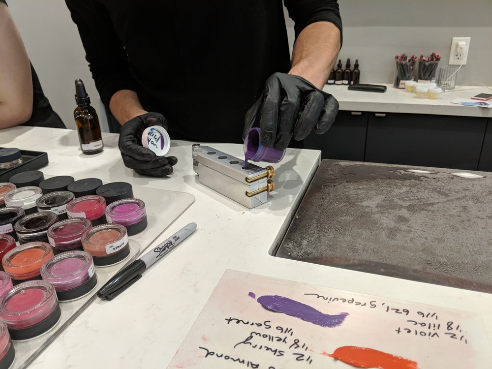 The Liquid Lipstick Being Poured into the Mold
