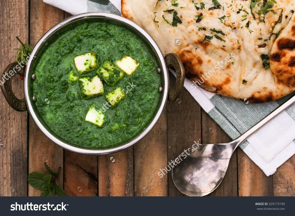 stock-photo-palak-paneer-and-garlic-naan-overhead-view-329173199.jpg
