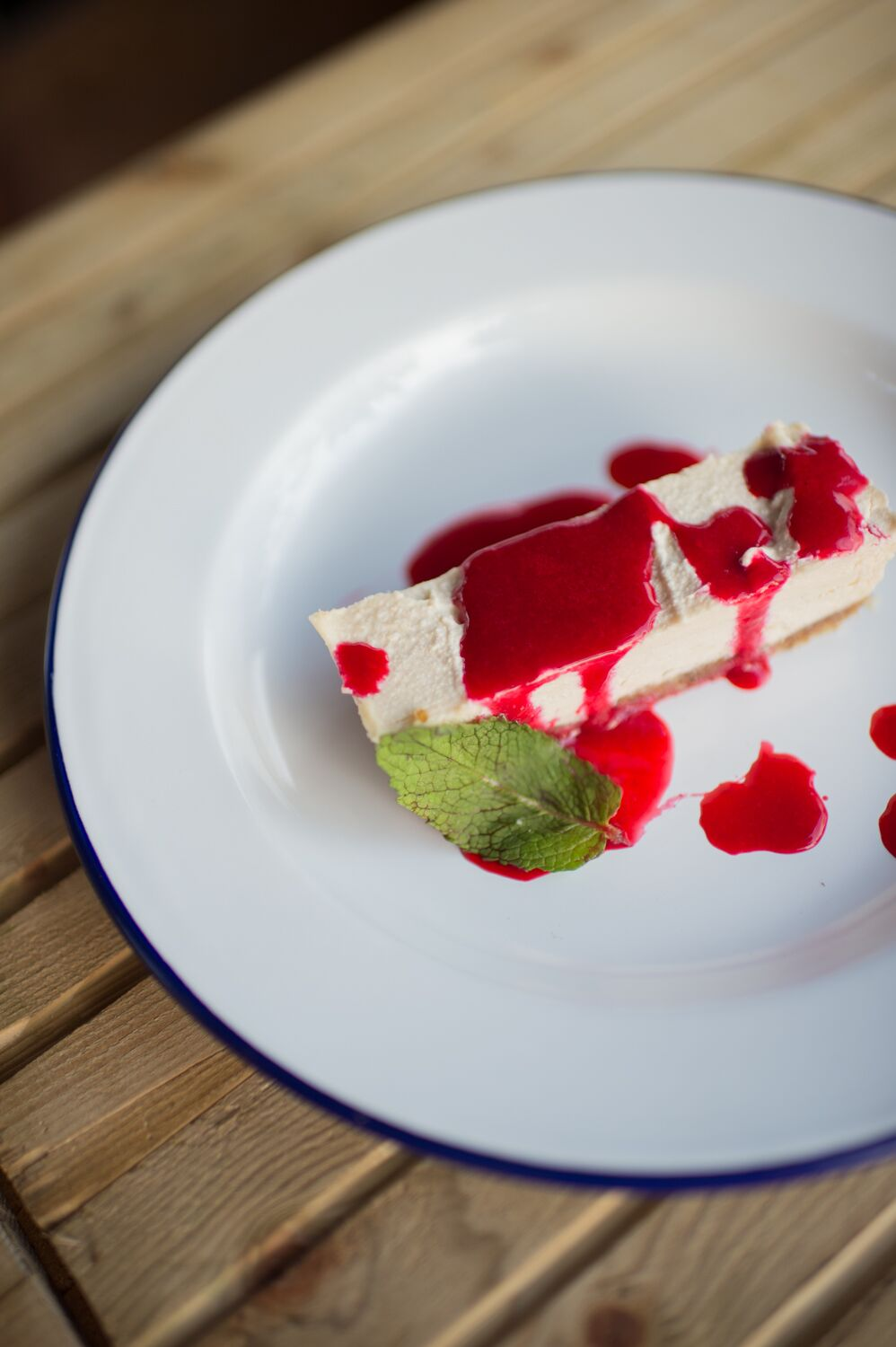 Vegan lemon cheesecake, raspberry coulis