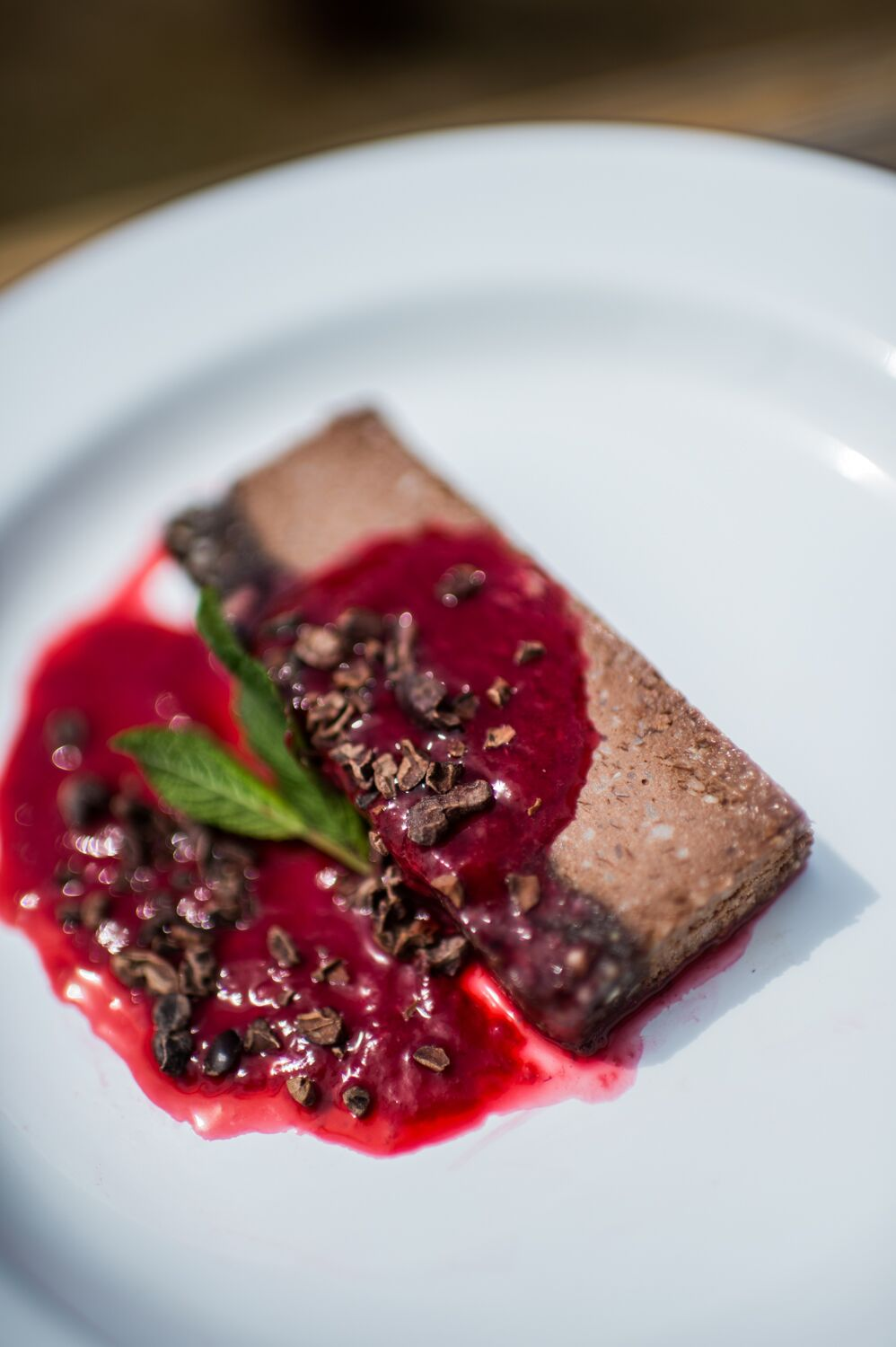 Raw chocolate cheesecake with cherry coulis