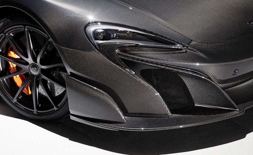 Visual carbon articulates the car's light weight, high power and boasts a 'muscular' exterior