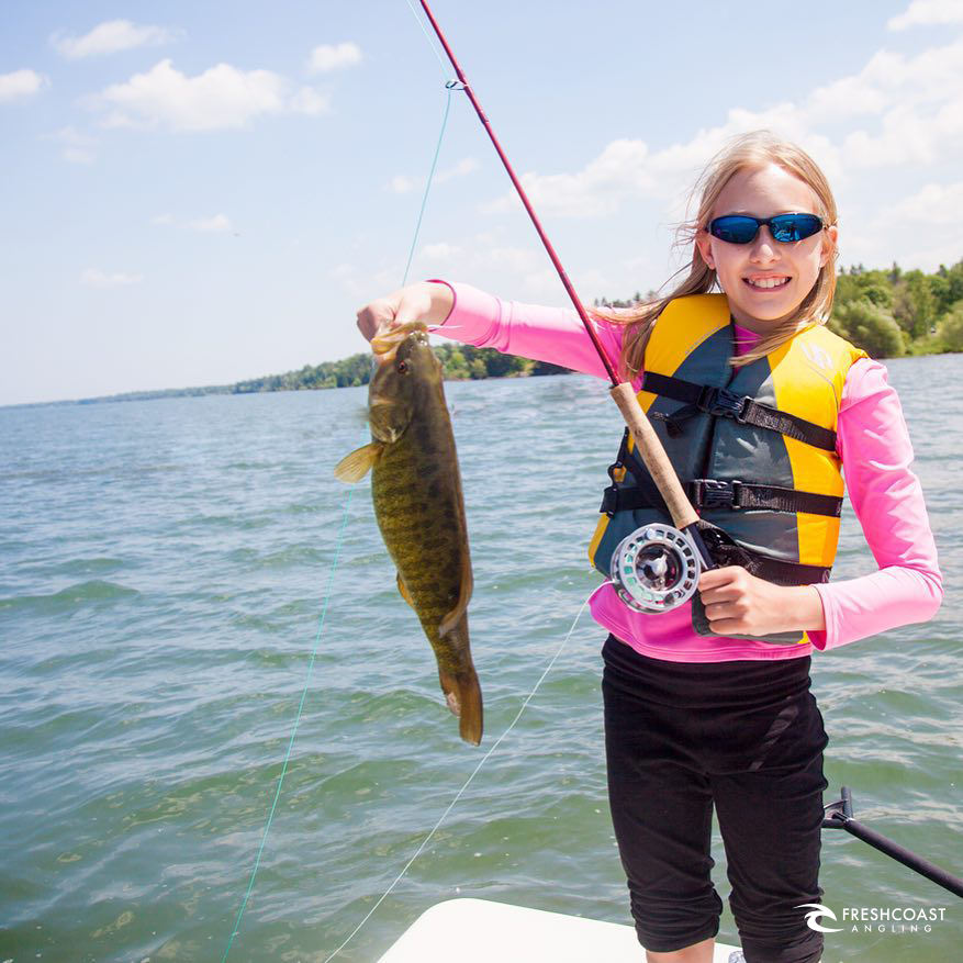Claire, age 11, and her first fish on a fly.  This is what's it's all about.   Photo: Captain Luke Kavajecz
