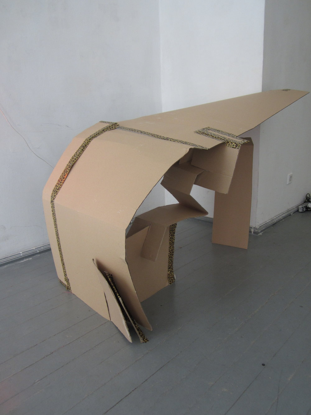 FlatPat (bent)    – leopard print gaffer tape and cardboard against wall, Labor Gallery, Budapest, dimensions decreasing, 2015