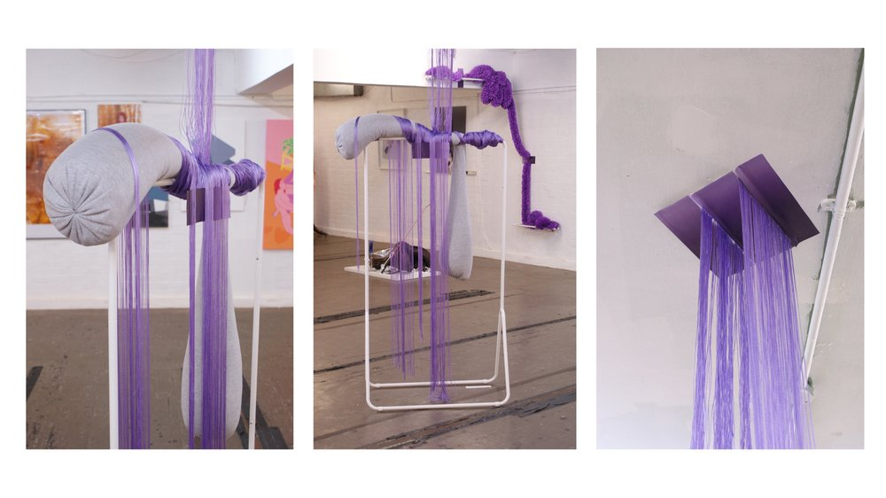 Lounge-Piece -    Stuffed and weighted grey marling with violet fringing and ombre stickers on white clothing rail, 2018, W98cm x H160cm/248cm x D60cm    Exhibited with    Festenforfagfolx (Universal Ornament 1)    as part of 'Queer Art(ists) Now' 2018.    Colour, forms and motifs call back and forth between the two works. Queerly hued and precariously placed, the works are assembled as both protective screening and a welcome in; pinked, fringed and shimmering, soft materials are stuffed to provide comfort and starched in readiness for celebration.