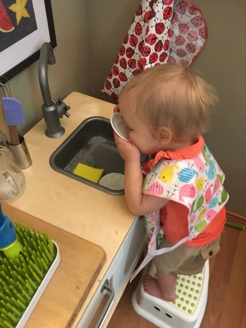 Noora doing dishes.