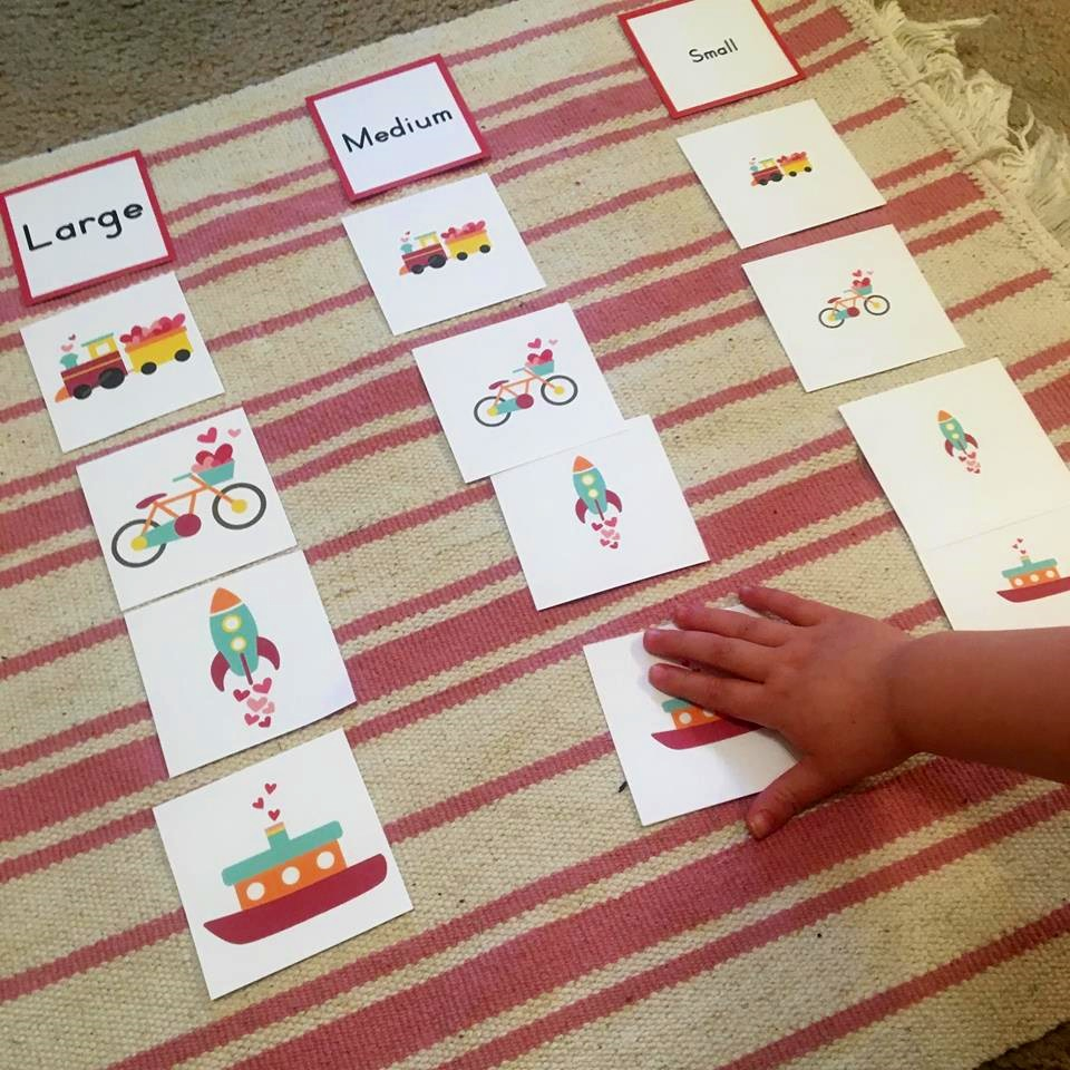 Size sorting is a great pre-language activity. I have a version of this (along with colour sorting and category sorting) on a small early language shelf all year round. And I also use them at home with Noora.