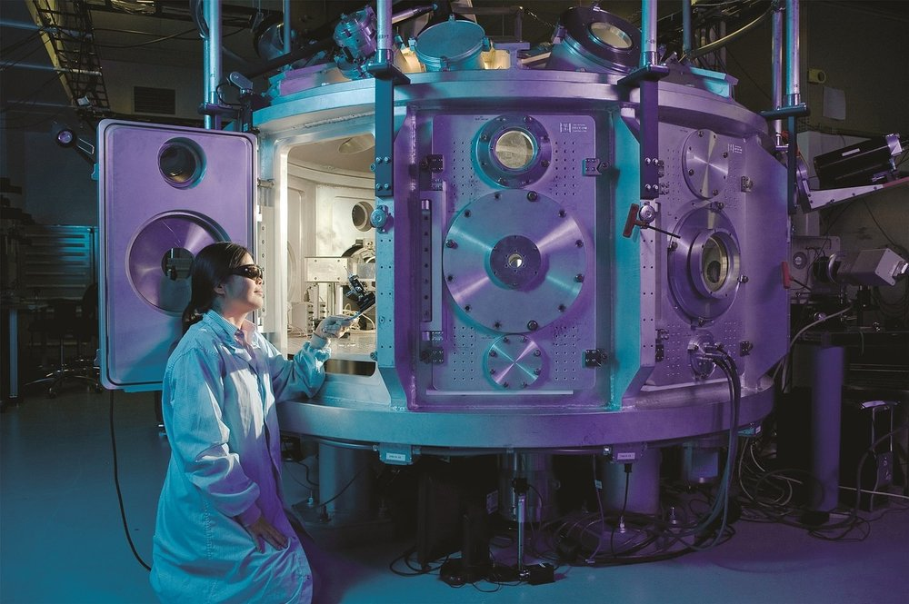 Scientist with Positron Chamber.jpg