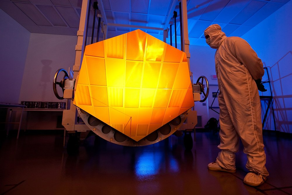 Scientist with space telescope mirror.jpg
