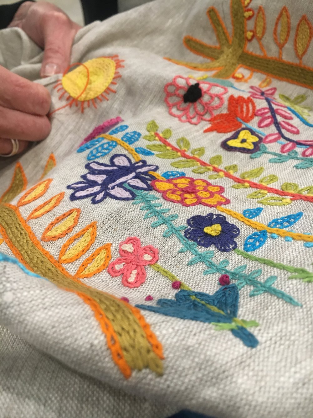 contemporary floral embroidery with bright colours